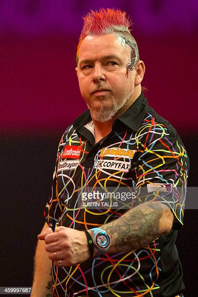 Britains Peter Wright reacts during the PDC World Championship darts final against Netherlands Michael van Gerwen at Alexandra Palace in north London...