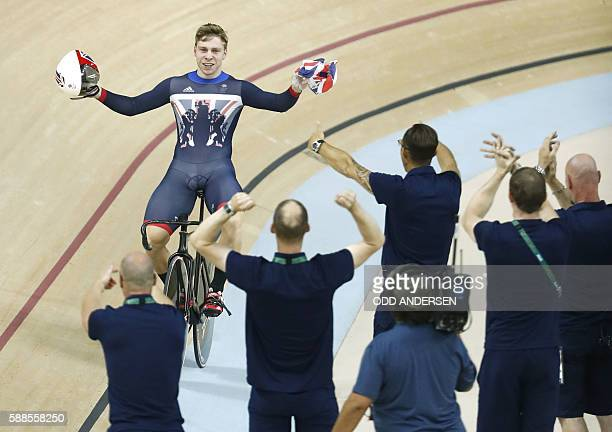 Britain's Philip Hindes celebrates after winning gold in the men's Team Sprint track cycling finals at the Velodrome during the Rio 2016 Olympic...