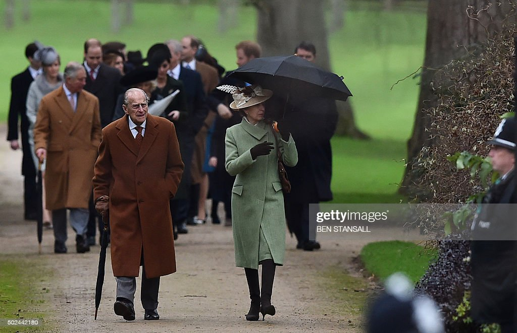 Britain's Phince Philip, the Duke of Edinburgh (L) and Britain's Princess Anne, Princess Royal (R) walk ahead of other members of the royal family for a traditional Christmas Day Church Service at Sandringham in eastern England, on December 25, 2015. STANSALL