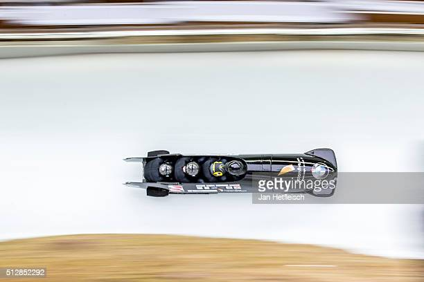 Britain's pilot John James Jackson and his pushers Ben Simons Bruce Tasker Joel Fearon compete during the second run of the IBSF Bobsleigh Skeleton...
