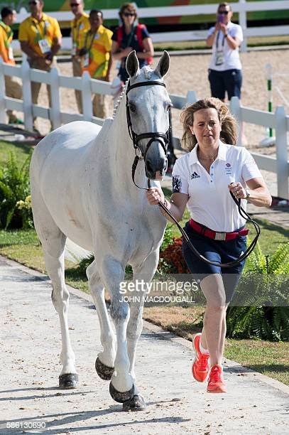 Britain's Pippa Funnel leads Billy the Biz to a trot during the first horse inspection of the Equestrian's Eventing phase during the 2016 Rio Olympic...