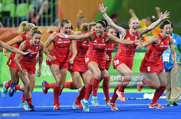 Britain's players celebrate their victory at the end of the women's Gold medal hockey Netherlands vs Britain match of the Rio 2016 Olympics Games at...