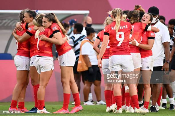 Britain's players hug each other after losing the women's bronze medal rugby sevens match between Fiji and Britain during the Tokyo 2020 Olympic...
