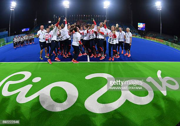 Britain's players pose with their gold medals during the women's field hockey medals ceremony of the Rio 2016 Olympics Games at the Olympic Hockey...