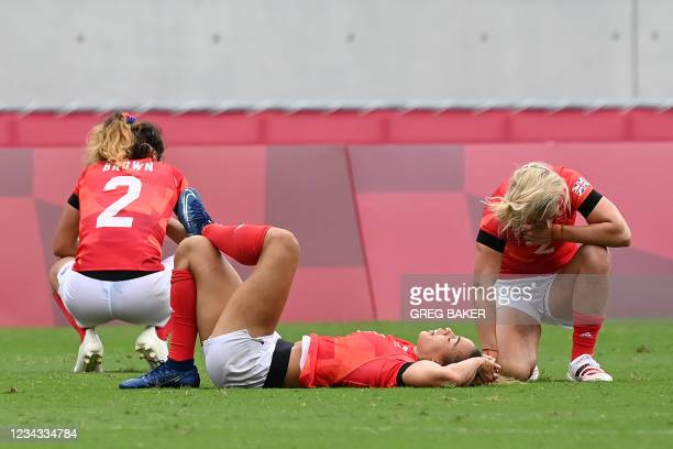 Britain's players react after losing the women's rugby sevens semi-final match between France and Britain during the Tokyo 2020 Olympic Games at the...
