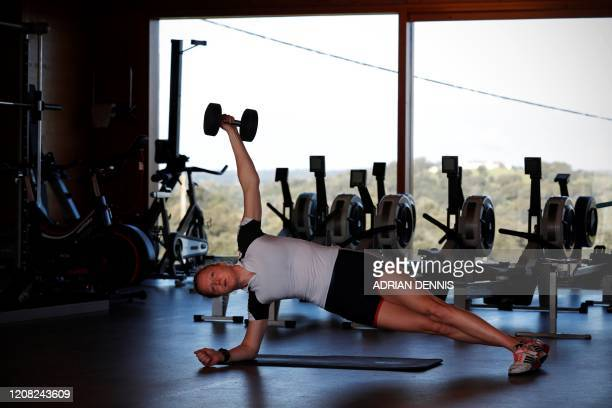 Britain's Polly Swann works on her core strength during a workout at a GB Rowing Team preOlympic 2020 training camp in Avis central Portugal on...