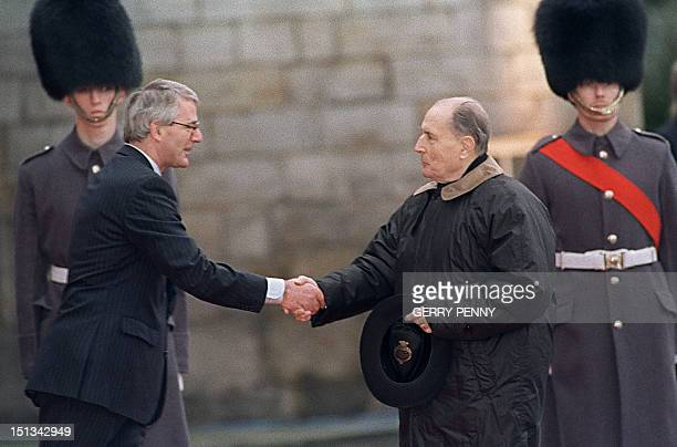 Britain's Premier John Major shakes hands with French President François Mitterrand at the beginning of a special twoday European Community leaders...