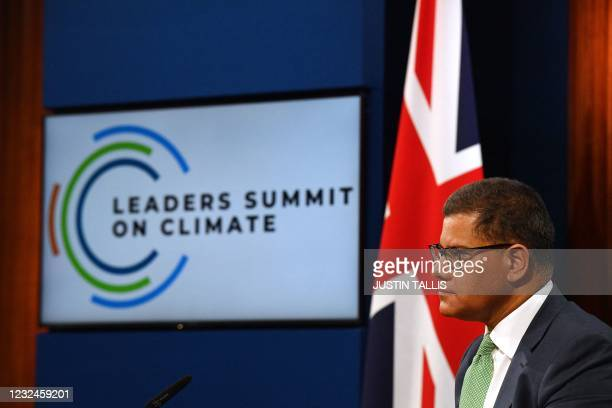 Britain's President for COP26 Alok Sharma listens to a speech from the virtual US Leaders Summit on Climate in the Downing Street Briefing Room in...