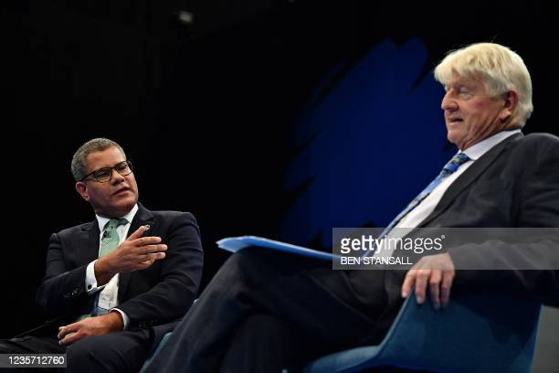 Britain's President for COP26 Alok Sharma reacts during a conversation with Stanley Johnson on the third day of the annual Conservative Party...