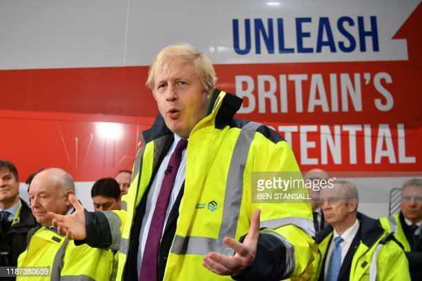 Britain's Prime Minister and Conservative leader Boris Johnson talks during a question and answer session on a general election campaign visit to...