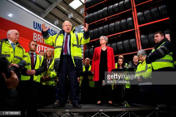 TOPSHOT Britain's Prime Minister and Conservative leader Boris Johnson talks during a question and answer session on a general election campaign...