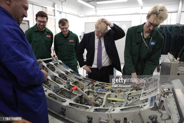 Britain's Prime Minister and Conservative Party leader Boris Johnson speaks to students at the International Aviation Academy on November 26 2019 in...