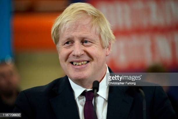 Britain's Prime Minister and Conservative party leader Boris Johnson delivers a speech during a general election campaign event at JCB construction...