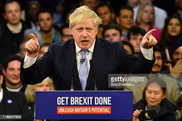 Britain's Prime Minister and Conservative party leader Boris Johnson speaks during a general election campaign rally in East London on December 11...