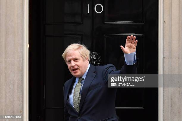 Britain's Prime Minister and Conservative Party leader Boris Johnson arrives at 10 Downing Street in central London on December 13 following an...