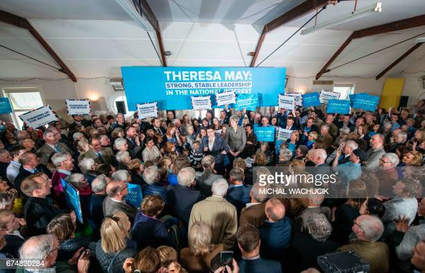 Britain's Prime Minister and Conservative Party leader Theresa May and Scottish Conservatives leader Ruth Davidson speak to supporters and guests in...