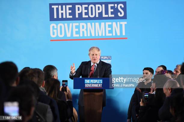 Britain's Prime Minister and leader of the Conservative Party, Boris Johnson makes a speech at QEII as the Conservatives celebrate a sweeping...