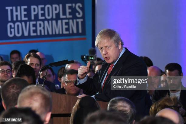 Britain's Prime Minister and leader of the Conservative Party Boris Johnson makes a speech at QEII as the Conservatives celebrate a sweeping election...