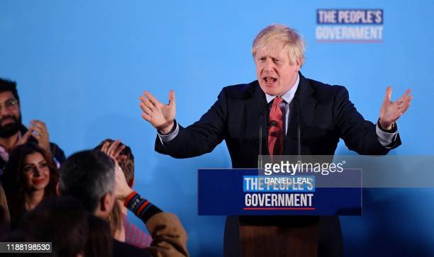 TOPSHOT Britain's Prime Minister and leader of the Conservative Party Boris Johnson speaks during a campaign event to celebrate the result of the...