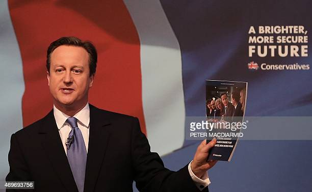 Britain's Prime Minister and leader of the Conservative Party David Cameron unveils his party's general election manifesto in Swindon southern...