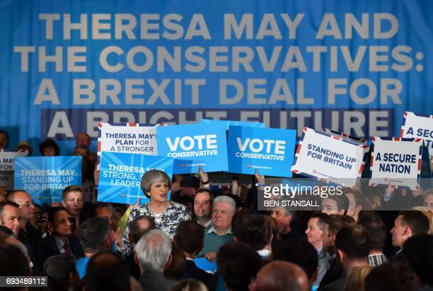 Britain's Prime Minister and leader of the Conservative Party Theresa May speaks during a general election campaign rally in Birmingham on June 7...
