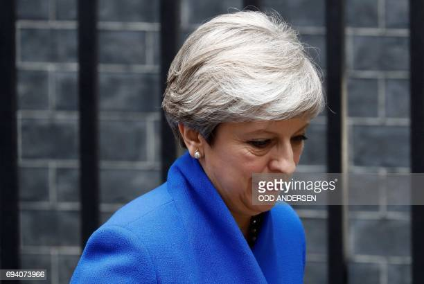 Britain's Prime Minister and leader of the Conservative Party Theresa May leaves 10 Downing Street in central London on June 9 en route to Buckingham...