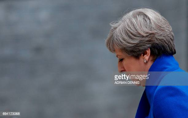 Britain's Prime Minister and leader of the Conservative Party Theresa May returns to 10 Downing Street in central London on June 9 2017 after making...