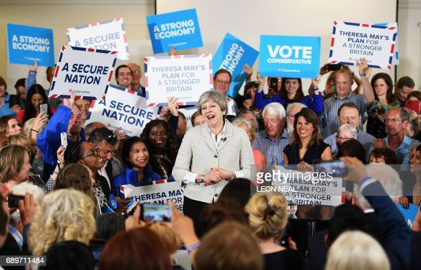 Britain's Prime Minister, and leader of the ruling Conservative party, Theresa May, speaks during a campaign event in south-west London on May 29 as...