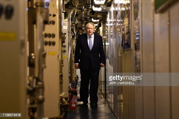 Britain's Prime Minister Boris Johnson aboard Vanguardclass submarine HMS Victorious during a visit to Faslane Naval base north of Glasgow in...