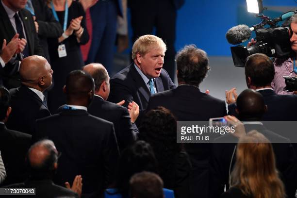 Britain's Prime Minister Boris Johnson acknowlodges the applause after delivering his keynote speech to delegates on the final day of the annual...