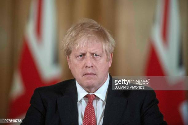 Britain's Prime Minister Boris Johnson addresses a news conference to give a daily update on the government's response to the novel coronavirus...