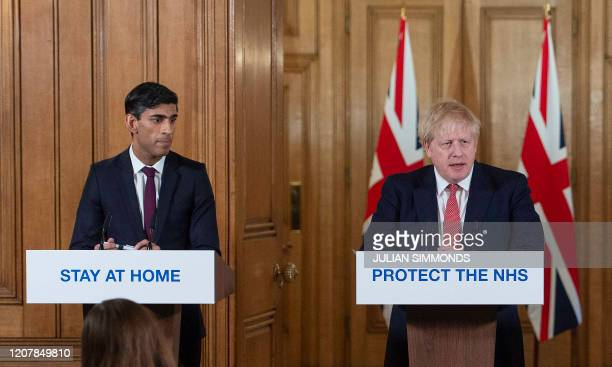 Britain's Prime Minister Boris Johnson and Britain's Chancellor of the Exchequer Rishi Sunak attend a news conference to give a daily update on the...