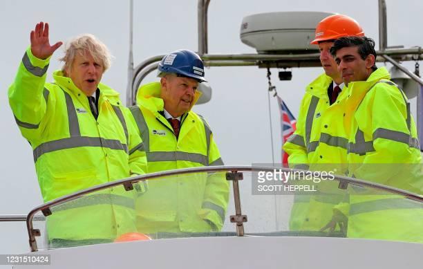 Britain's Prime Minister Boris Johnson , and Britain's Chancellor of the Exchequer Rishi Sunak talk with PD Ports CEO Frans Calje and PD Ports COO &...