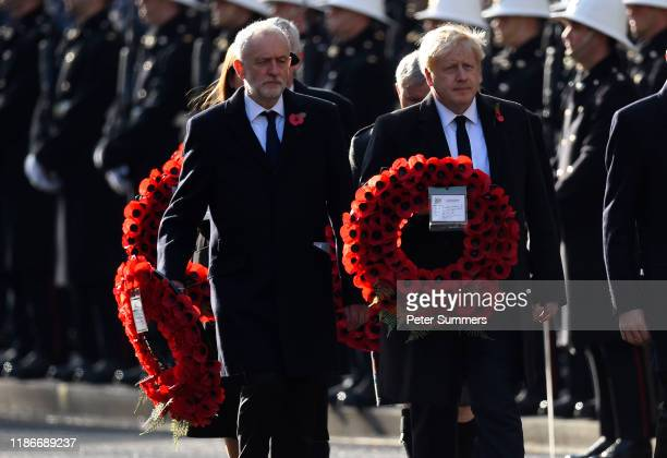 Britain's Prime Minister Boris Johnson and Britain's Labour Party leader Jeremy Corbyn prepare to lay wreaths as they take part in the annual...