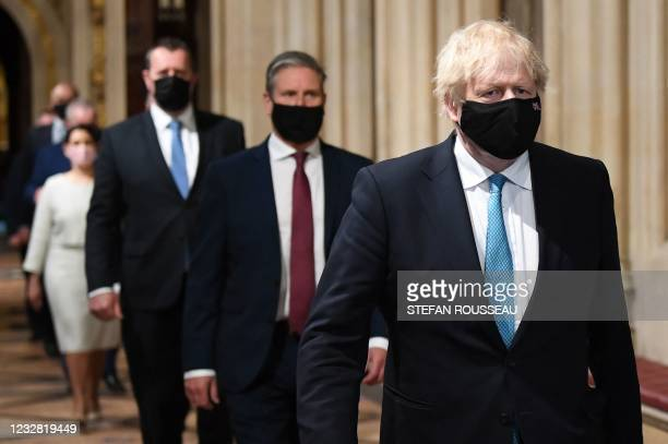 Britain's Prime Minister Boris Johnson and Britain's main opposition Labour Party leader Keir Starmer , both wearing face coverings, lead MPs in a...