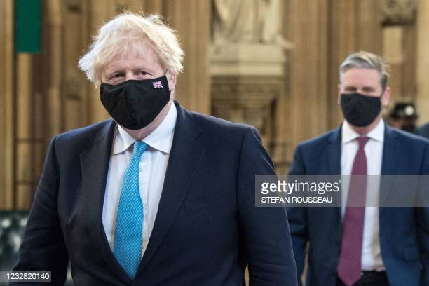 Britain's Prime Minister Boris Johnson and Britain's main opposition Labour Party leader Keir Starmer, both wearing face coverings, lead MPs in a...