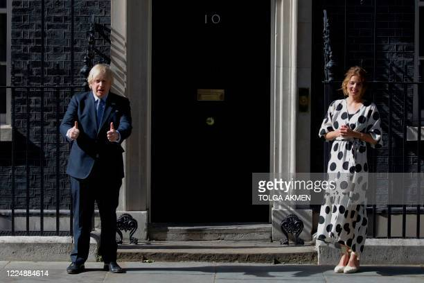 Britain's Prime Minister Boris Johnson and Clap for Carers founder Annemarie Plas participate in a national NHS celebration clap outside 10 Downing...