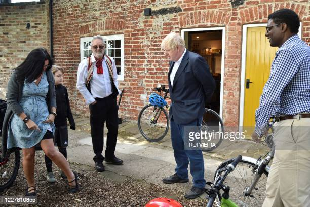 TOPSHOT Britain's Prime Minister Boris Johnson and Conservative MP Darren Henry talk with local people at the Canal Side Heritage Centre in Beeston...