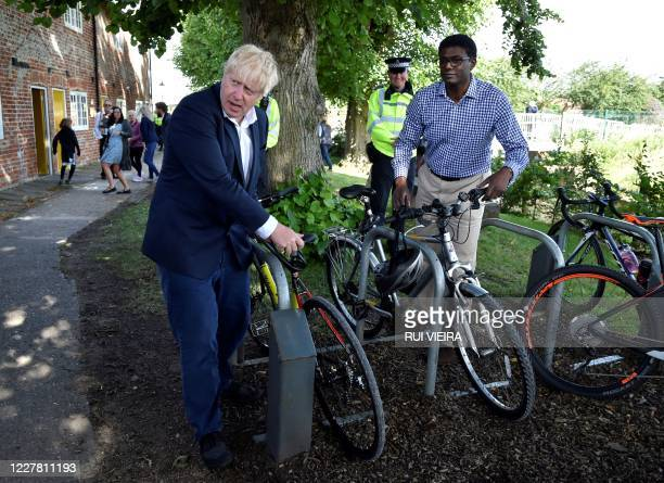 Britain's Prime Minister Boris Johnson and Conservative MP Darren Henry rest their bikes at the Canal Side Heritage Centre in Beeston, central...