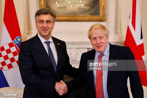 Britain's Prime Minister Boris Johnson and Croatia's Prime Minister Andrej Plenkovic shake hands ahead of a meeting at 10 Downing Street on February...