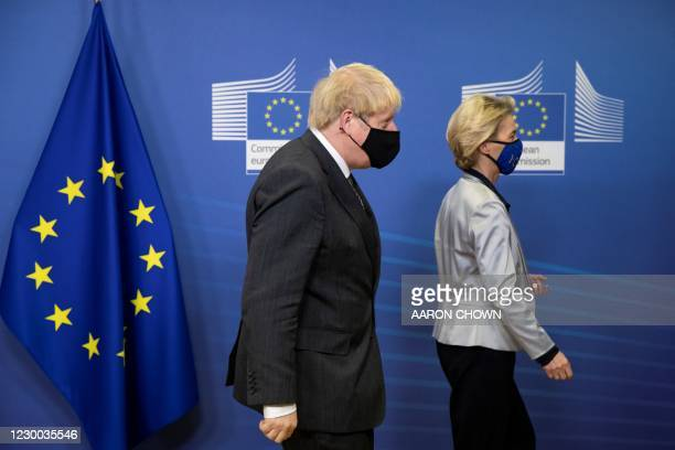Britain's Prime Minister Boris Johnson and European Commission President Ursula von der Leyen leave after meeting the media in the Berlaymont...