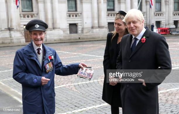 Britain's Prime Minister Boris Johnson and his parter Carrie Symonds meet veterans at the Remembrance Sunday ceremony at the Cenotaph on Whitehall in...