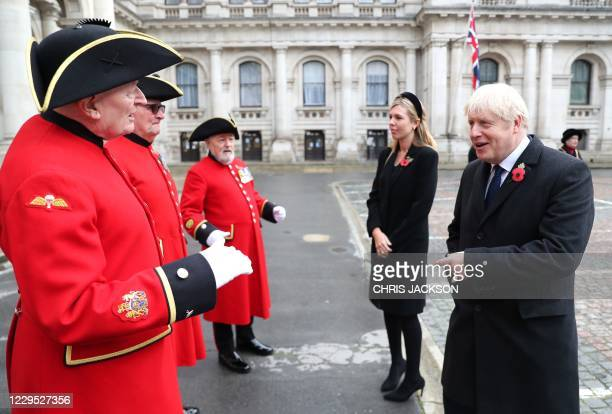 Britain's Prime Minister Boris Johnson and his partner Carrie Symonds meet Chelsea Pensioners and war veterans during the Remembrance Sunday ceremony...