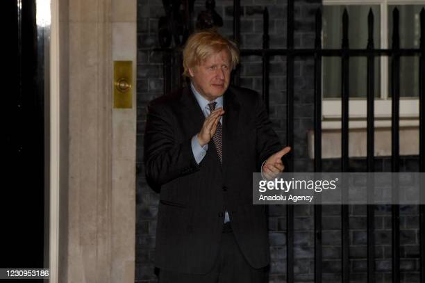Britain's Prime Minister Boris Johnson and his partner Carrie Symonds come out of 10 Downing street in central London on February 3, 2021 to take...