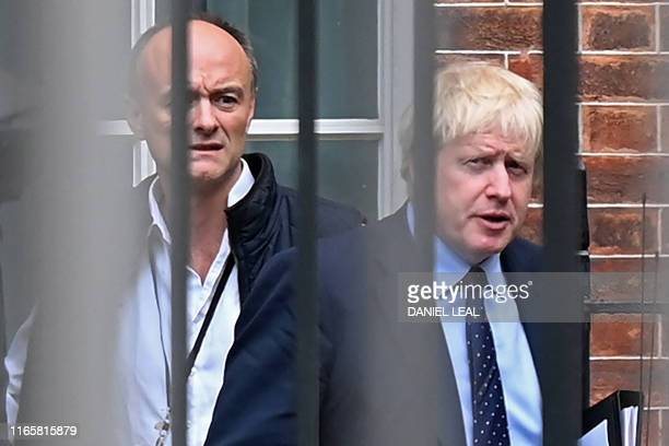 Britain's Prime Minister Boris Johnson and his special advisor Dominic Cummings leave from the rear of Downing Street in central London on September...