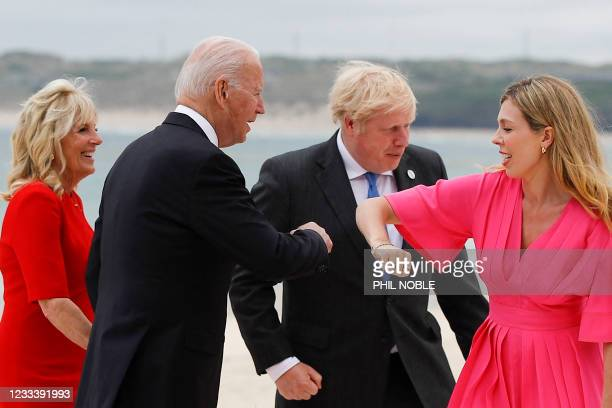 Britain's Prime Minister Boris Johnson and his spouse Carrie Johnson greet US President Joe Biden and first lady Jill Biden during the G7 summit in...
