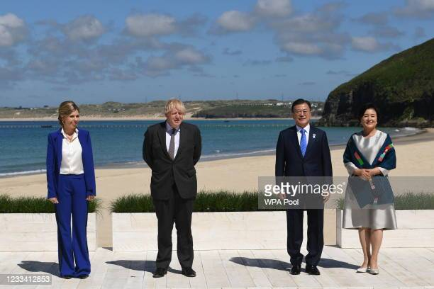 Britain's Prime Minister Boris Johnson and his spouse Carrie Johnson stand alongside South Korea's President Moon Jae-in and First Lady Kim Jung-sook...