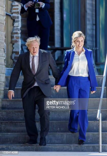 Britain's Prime Minister Boris Johnson and his wife Carrie Johnson arrive on the beach for a welcome event at the G7 summit in Carbis Bay, Cornwall...