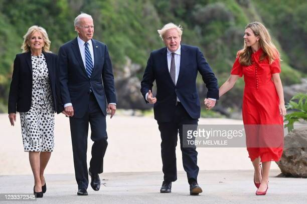 Britain's Prime Minister Boris Johnson and his wife Carrie Johnson walk with US President Joe Biden and US First Lady Jill Biden outside Carbis Bay...