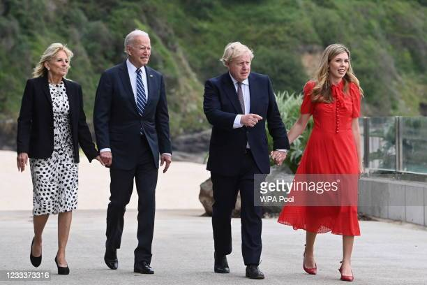 Britain's Prime Minister Boris Johnson and his wife Carrie Johnson walk together with U.S. President Joe Biden and First Lady Jill Biden outside the...